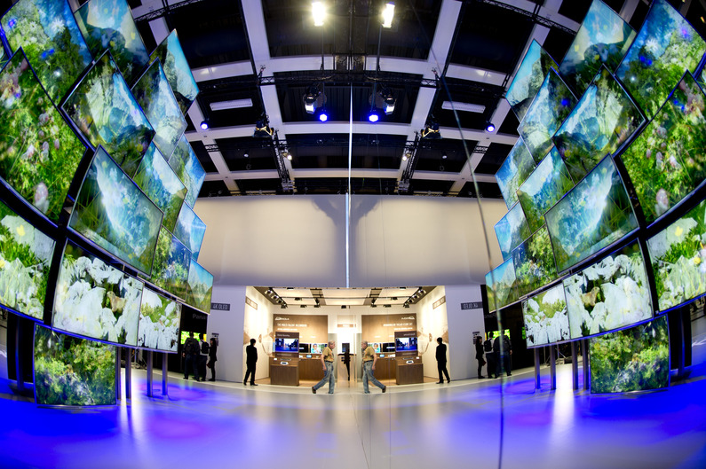 TV screens reflected in a mirror are seen at the Japanese electronics company Panasonic booth at the 53rd IFA electronics trade fair (Internationale Funkausstellung) in Berlin on September 5, 2013. IFA, Europe's largest consumer electronics and home appliances fair opens on September 6 to September 11, 2013.  AFP PHOTO / ODD ANDERSEN