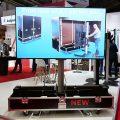 Audipack FLM-100W : un chariot motorisé Liftomatic dans un flight case sur roulettes